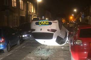 incredible picture shows car flipped upside down on quiet cambridge street