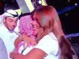 female judge of saudi pop idol show sparks outrage after hugging winner