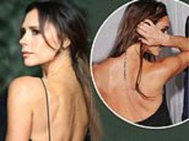 Victoria Beckham shows tattoo tribute to husband David has all but vanished after laser treatment