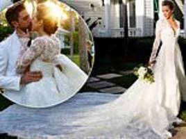 arrow star katie cassidy is a stunning bride in lace gown with 10-foot train