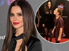 cheryl delights a young fan by 'flossing' with her on the red carpet for the greatest dancer launch