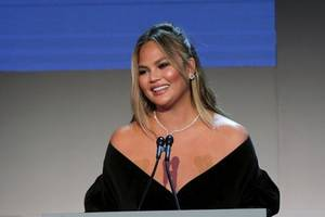 chrissy teigen's dad shows his love with a tattoo of her face for her birthday