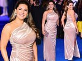Mary Poppins Returns: Kelly Brook displays her voluptuous curves in form-fitting blush pink gown