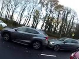 motorist tells cyclist he can drive safely while using phone... only to crash moments later