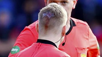 football fan fined and banned for throwing coin at linesman