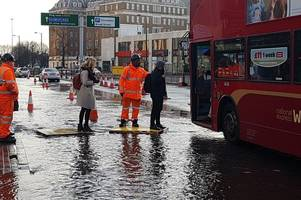 watch: hagley road bus passengers use pallets to avoid flood waters after pipe bursts