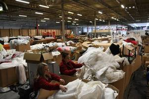 woman whose wedding dress was lost when a bridal shop went bust miraculously finds it in a warehouse among 20,000 other gowns
