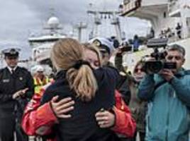 british sailor embraces mother as she returns to chilean shore days after rescue from capsized yacht