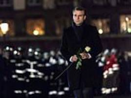 French President Emmanuel Macron visits Strasbourg Christmas market to pay his respects to victims