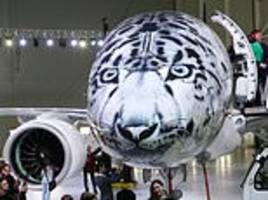 Paw-some paint job! Embraer E190-E2 airliner with an incredible snow leopard livery is unveiled