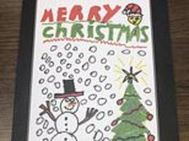 theresa may sends out child's drawing for christmas while corbyn gets his cat out
