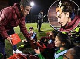 arsenal's laurent koscielny and lucas torreira deliver christmas gifts