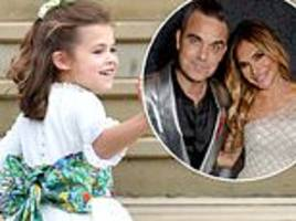robbie williams reveals daughter teddy, 6,told him and wife ayda field they 'can't hide her anymore'