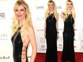 tara reid displays her svelte frame in sequinned gown with cutaway sides as she hits the red carpet
