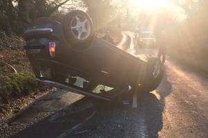 road near bristol closed in both directions after car flips in crash