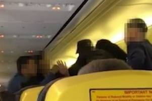 watch as fight breaks out on ryanair flight and a man is detained at stansted airport
