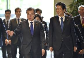 s.korea's moon urges restrained language in forced labour row with japan