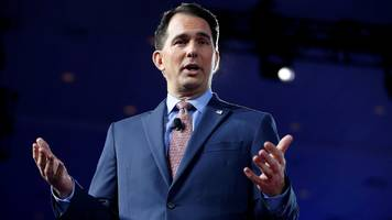 wisconsin's scott walker strips incoming democrat's powers