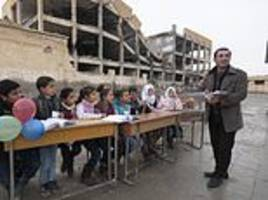 schoolchildren in raqqa finally have their first lessons in four years after isis's reign of terror