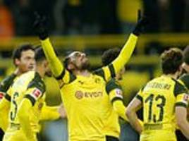 lucien favre's side extend their lead to nine points after goals from marco reus and paco alcacer