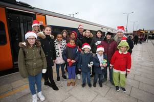underprivileged children ride on grinch-themed christmas train from nottingham station