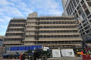 footage shows woking victoria square progress as scaffolding appears around toys 'r' us