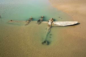 the maid of harlech: the world war two american fighter plane that's spent decades buried under the sand of a welsh beach