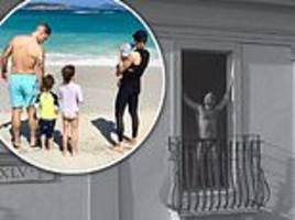 ayda field shares a sweet family holiday snap of her brood on the beach