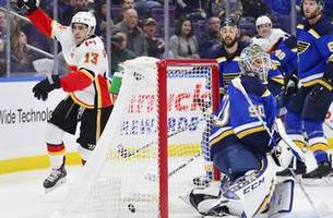 blues allow four goals in first period, lose 7-2 to flames