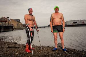 Storm Deirdre doesn't deter hardy swimmers on their Dip-a-Day in December for poorly children