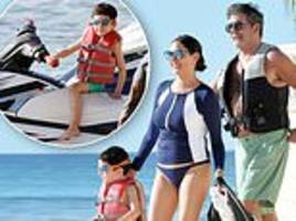 simon cowell takes son eric jet-skiing as he and girlfriend lauren silverman relax at the beach