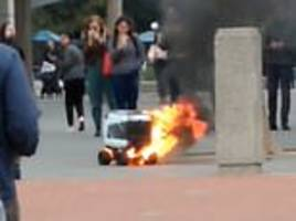 Robot bursts into flames on a university campus in San Francisco as it dropped off a take away