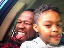 "50 cent clocks in x-mas daddy duties w/ son sire jackson: ""my dad's the best b*tches"""