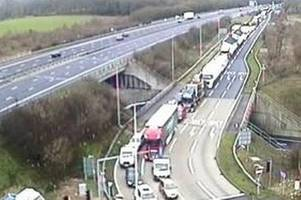 motorcyclist dies after hitting debris in m4 crash - heavy traffic as motorway to remain closed for 'several hours'
