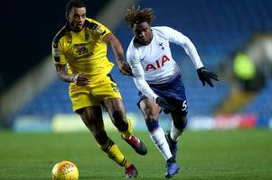 cheltenham town will host oxford united in checkatrade trophy after league one side knock out tottenham hotspur under-21s