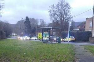 two arrests after pedestrian injured in car crash at dorking bus stop