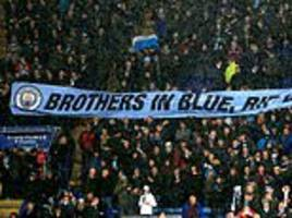 Manchester City fans unfurl banner in tribute to late Leicester owner
