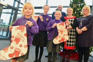 Schoolgirls see their winning designs turned into Christmas stockings