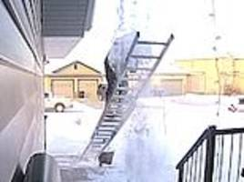 Man putting up his Christmas decorations falls off ladder