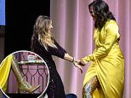 michelle obama dresses to impress in $4,000 glittery thigh-high balenciaga boots and yellow gown