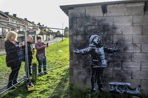 banksy's latest creation depicts a kid licking ash out of the air, and it calls attention to a global health crisis