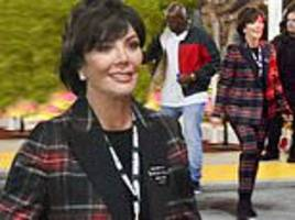 kris jenner is all smiles as she arrives at travis scott's concert with corey gamble