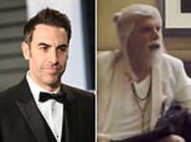 sacha baron cohen reveals cut scene in which hotel concierge agrees to get him date with young boy