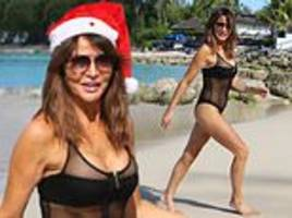 lizzie cundy, 50, shows off her incredible figure in a mesh swimsuit as she celebrates christmas