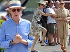 paul mccartney boards a yacht in st barts with wife nancy shevell and daughter stella