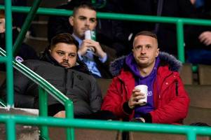celtic star leigh griffiths attends hibs vs hearts as he continues break from game