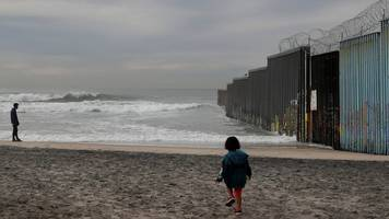 mexico wall: trump aide says concrete wall idea was dropped early on