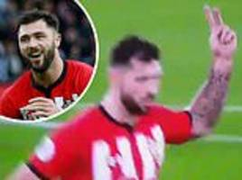 charlie austin approached by fa to explain two-fingered gesture to fans