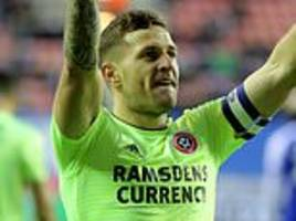 championship round-up: sheffield united go third with victory at wigan
