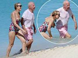 jerry hall and husband rupert murdoch sweetly hold hands during refreshing swim in barbados